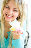 Woman with candies. Young happy woman with candies Royalty Free Stock Images