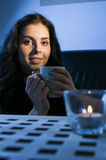 Woman with candle Stock Image