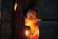 Woman with a candle Stock Image