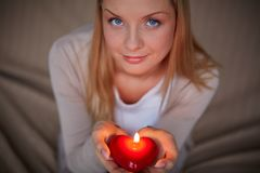 Woman with candle Royalty Free Stock Photography