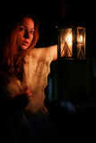 Woman candle lamp dark night Royalty Free Stock Images