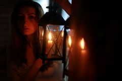 Woman candle lamp dark night royalty free stock image