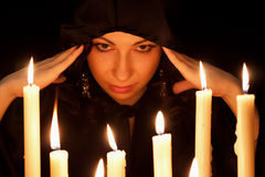 Woman  with candles Royalty Free Stock Photography