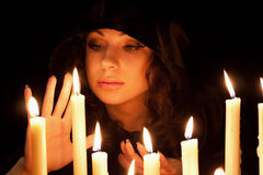Woman  with candles. Young beautiful soothsayer with candles Stock Images