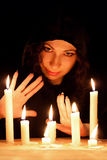 Woman with candles. Young beautiful soothsayer with candles Stock Photos