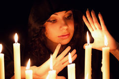 Woman with candles Royalty Free Stock Images