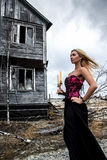 Woman with candles at the background of the old house Stock Photo