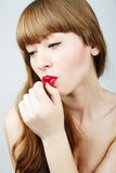 Woman with a candy Stock Photography