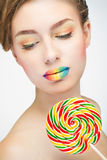 Woman with candy Royalty Free Stock Photos