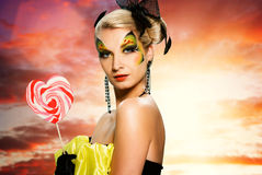 Woman with candy Royalty Free Stock Photo