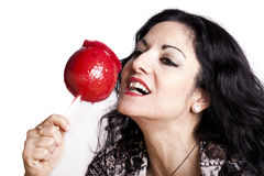 Woman With Candy Apple Royalty Free Stock Photos