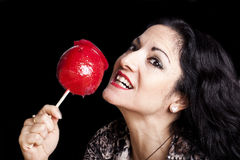 Woman With Candy Apple On Black Stock Photo