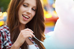 Woman with candy floss. In the lunapark Royalty Free Stock Photography