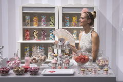Candy Shop with beautiful Woman Stock Images