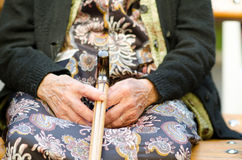 Woman with a cane Stock Images