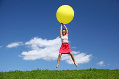 Woman by canicular day descend on ball Royalty Free Stock Photo