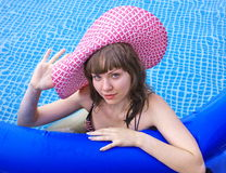 Woman is by a canicular day  in a pool Royalty Free Stock Photography