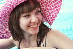Woman is by a canicular day  in a pool Royalty Free Stock Image
