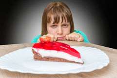 Woman cannot resist the temptation and wants to eat sweet cake Stock Photo