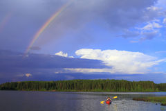 Woman canoeing Stock Image