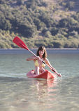 A woman canoeing on a lake Stock Photography