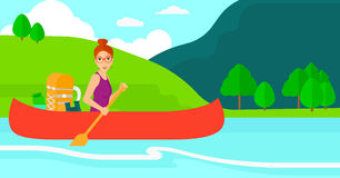 Woman canoeing on the river. Royalty Free Stock Image