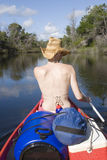Woman canoing from behind portrait Royalty Free Stock Images