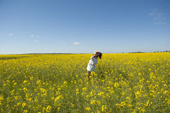 Woman in Canola Field Royalty Free Stock Image