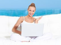 Woman on canopied seat with laptop Royalty Free Stock Photos