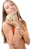 Woman with cantaloupe stock photography