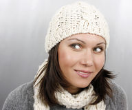 Woman in cap and scarf Stock Photos