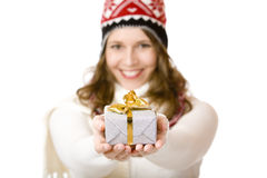 Woman with cap and scarf holding Christmas gift Royalty Free Stock Image