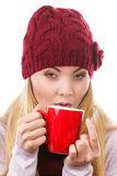 Woman in cap and shawl holding gingerbread and cup of hot tea, christmas time Stock Photo
