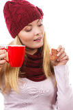 Woman in cap and shawl holding gingerbread and cup of hot tea, christmas time Stock Image