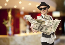 Woman in cap throwing dollar Royalty Free Stock Photography
