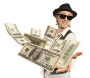 Woman in cap throwing dollar Stock Photography