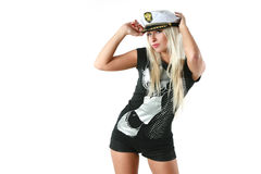 Woman in a captain's hat Stock Images