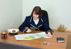 Woman - captain at a table Royalty Free Stock Photo