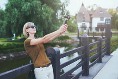 Woman capturing herself with personal camera Royalty Free Stock Photos