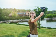 Woman capturing herself with personal camera Royalty Free Stock Photo