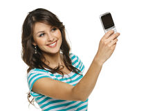 Woman capturing photo of herself on cellphone Royalty Free Stock Image