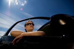 Woman in a car 1. A young woman looks out into the distance from her car Royalty Free Stock Images