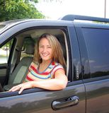 Woman and Car. A beautiful young woman driving a car, could be a soccer mom, or great auto insurance pic