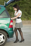 Woman by car Stock Photography