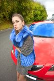 Woman and car Stock Images