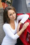 Woman with car. Picture of the beautiful girl with a red mustang convertible Royalty Free Stock Images