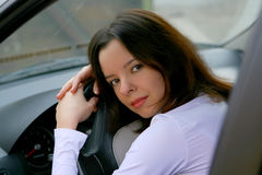 Woman in car. Young beautiful woman laying on the car weel Royalty Free Stock Photos