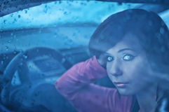 Woman in car. Portrait of beautiful woman in car royalty free stock photography