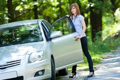 Woman with car Stock Image