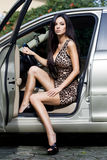 Woman at the car Royalty Free Stock Image